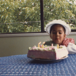 I loved that dress and that hat. And the tablecloth is pretty nifty too. Do you see the cake?